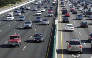 Falling gas prices fuel increase in holiday travel, AAA says
